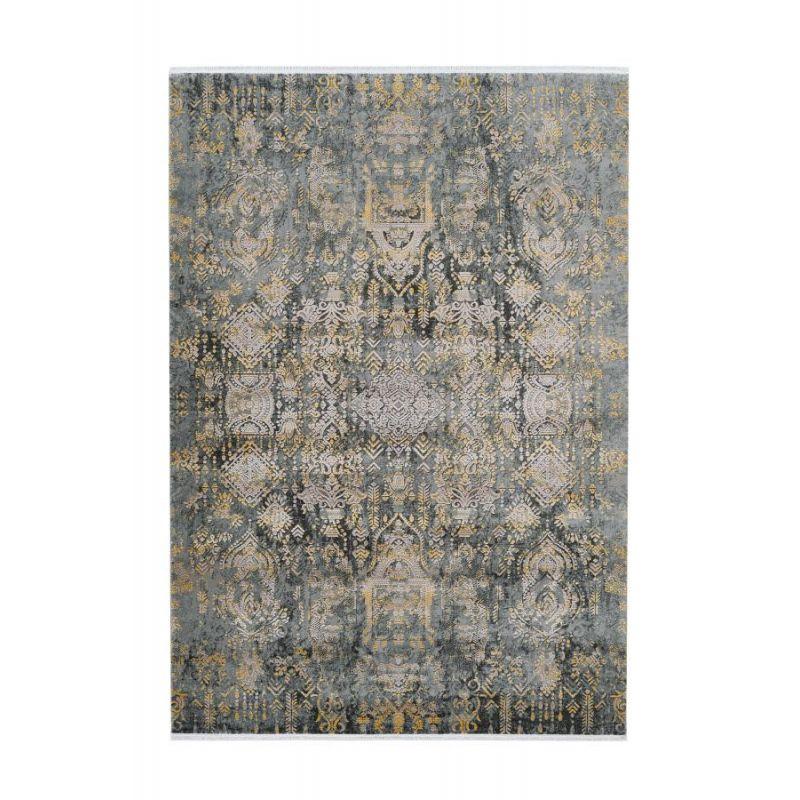 Vysoko kvalitný koberec s orientálnym dizajnom a žltkastým motívom. Hodí sa do elegantného interiéru. Dizajn od Pierre Cardin