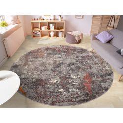 Je možné objednať aj kruhový koberec v šedo ružovej farbe. Ideálne pod kreslo.