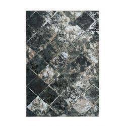 Extravagantný tmavý koberec s abstraktným motívom. Príjemný na dotyk, tlmí hluk.